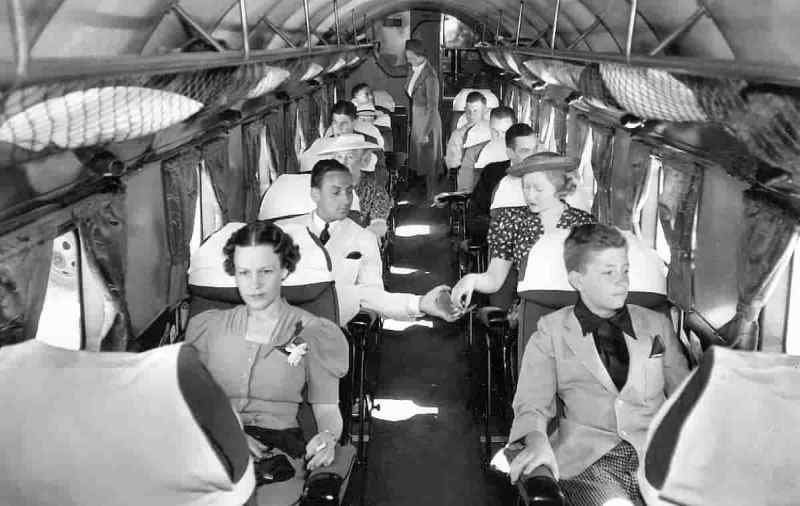 On-board a Douglas DC-2-120 aircraft owned by the American Delta Air Lines founded in 1924.